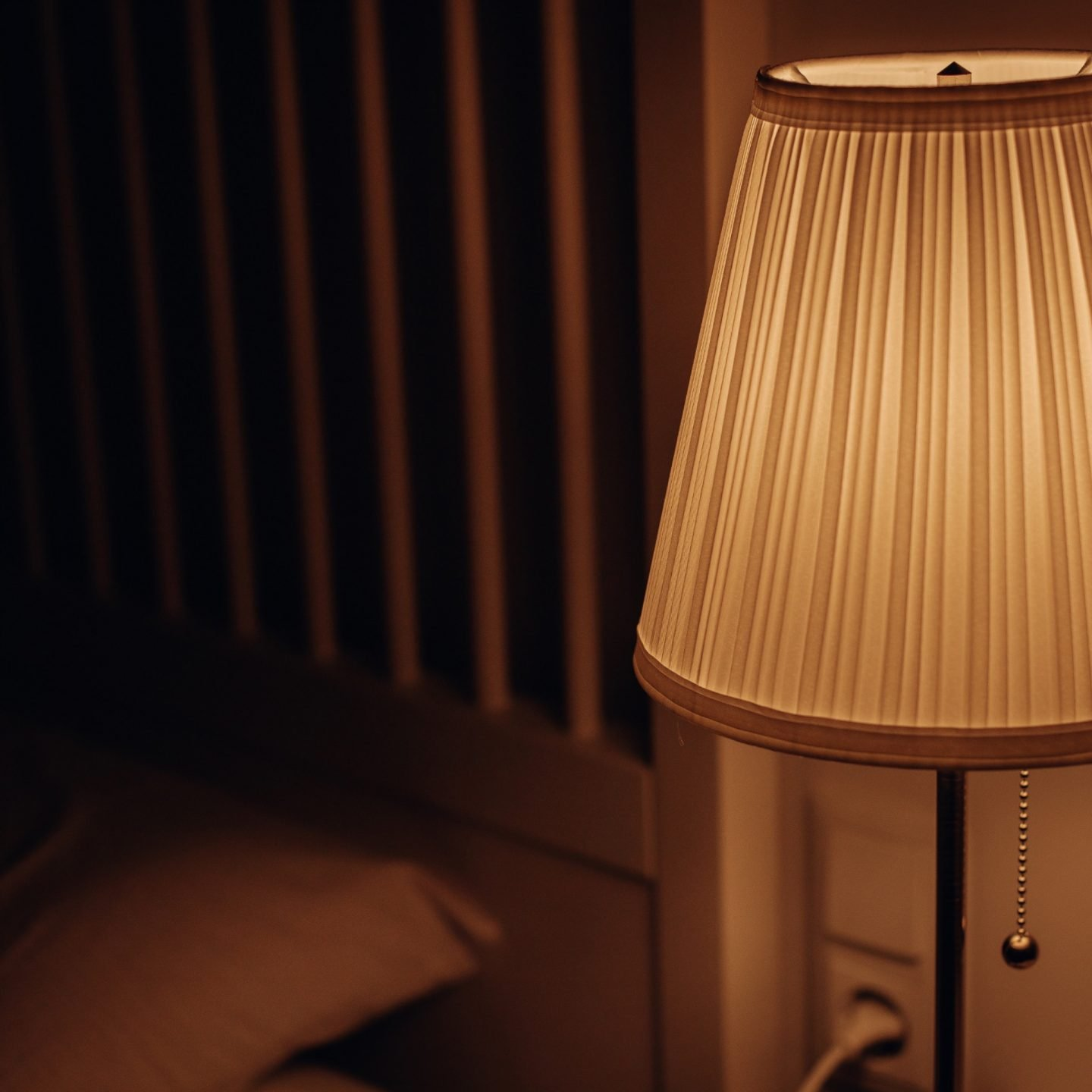 a bed side lamp with its soft glowing light on