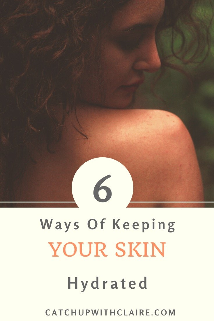 A lady looking back to the top of her healthy glowing skin on her shoulder